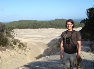Enjoying a the sand dunes of Fraser Island after a climb.